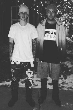Justin Bieber wearing  Faith Connexion Graffiti Print Track Pants, Casely Hayford Double Hem Cotton Jersey T-shirt, Yea. Nice The Legend Beanie, Adidas Yeezy Season 1 950 Boots