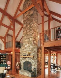 Fireplace between balcony in timber frame Great Room