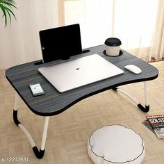 Laptop Adaptor Smart Multi-Purpose Laptop Table with Dock Stand/Study Table/Bed Table/Foldable and Portable/Ergonomic & Rounded Edges/Non-Slip Legs/Engineered Wood (GREY) Product Name: Smart Multi-Purpose Laptop Table with Dock Stand/Study Table/Bed Table/Foldable and Portable/Ergonomic & Rounded Edges/Non-Slip Legs/Engineered Wood (GREY) Brand Name: SHIV ENTERPRISE Color: Grey Compatibility: Laptops Multipack: 1  Sizes Available: Free Size   Catalog Rating: ★4.4 (306)  Catalog Name: SHIV ENTERPRISE Laptop Adapters CatalogID_2339555 C106-SC1537 Code: 895-12212931-