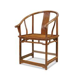 A huanghuali horseshoe-back armchair. Early Qing Period, Qing Dynasty (1644-1911). Photo China Guardian