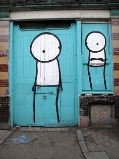 stick people on blue door. street art