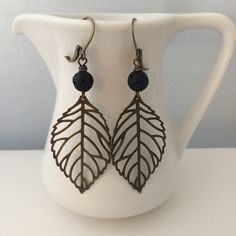 """Bronze leaf earrings | $18 ______________________________________ #GiraffeDesigns #jewelry #earrings #handmade #bronze #leaf #black #beads"""