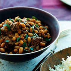 """""""Lebanese Lamb and Bean Stew Recipe Main Dishes with dried navy beans, lamb shoulder, baharat, water, olive oil, onions, garlic cloves, salt, black pepper, tomato paste""""  http://www.yummly.com/recipe/Lebanese-Lamb-And-Bean-Stew-Epicurious?columns=4"""