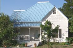This frame  house with a blue metal roof was built for H. L. Tate, Sr. in 1905.