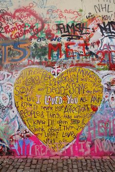 """'Heart on the Lennon Wall' by Beth_MacKenzie. Once a normal wall, since the 1980s it has been filled with John Lennon-inspired graffiti and lyrics. The wall represents a symbol of youth ideals such as love and peace."""