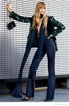 70s Cool–Gracing the pages of Vogue Russia's December issue, Ieva Laguna channels her inner 1970s diva for this fashion editorial captured by Bjarne Jonasson of Atelier Management. Styled by Katerina Zolototrubova, the blonde beauty wears a mix of thigh high boots, tailored blazers and semi-sheer shirts with a long hairstyle featuring bangs. / Hair by …