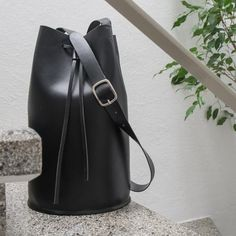 Handmade leather bucket bag. Bucket bag made out of veg tan leather from Tuscany.