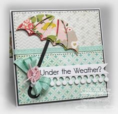 A card featuring the latest must have Die-namics/stamp set combo from MFT - Umbrella.  More info on [url=http://scrapmyheartout.blogspot.com/2012/03/mft-teasers-day-4-under-weather.html]my blog.[/url]  Thanks for looking!!   Stamps: Umbrella stamp set (MFT) Papers: Paper Heart 6x6 pad (Crate), Black Licorice, Sweet Tooth (MFT) Inks: Memento tuxedo black (Tsukineko) Accessories: Umbrella Die-namics, Mini Monarch Border Die-namics, Oval Open Scallop Doily Duo Die-namics, Sweet Stack Label…