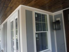Close-up of Cobblestone trim and stained car siding porch ceiling Hardie Board Siding, Board And Batten Siding, Andersen Windows, Porch Ceiling, New Construction, Sweet Home, Exterior, Building, Car