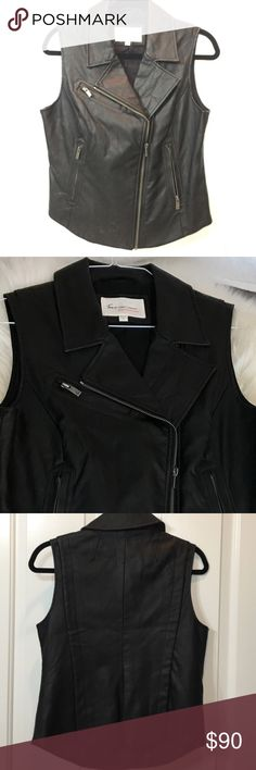 """Two by Vince Camuto Black Faux Leather Moto Vest S This beautiful and edgy Two by Vince Camuto Faux Leather Moto Vest adds edge and style to any outfit. Fitted with asymmetrical zip. Rounded hemline. Black with silver zipper and accents. New without tags - perfect condition. Size small. Measures approx.: 19"""" shoulder to short hem, 24"""" shoulder to longest part of hem, 18"""" chest, 17"""" waist. Two by Vince Camuto Jackets & Coats Vests"""