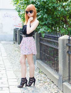 Floral shorts and gladiator booties.