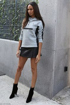 Strike a pose: The Puerto Rican beauty looked the height of grungy chic in a thigh-skimming leather skirt, suede ankle boots and a Puma sweatshirt
