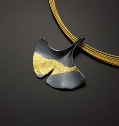 Ginkgo leaf silver pendant with fine gold by KAZNESQ in Japan