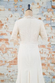lace wedding dress with sleeves. I love the buttons, too! But I would only want the dress to come up to my shoulder blades so that it can be off the shoulder. Perfect sleeve length though!!