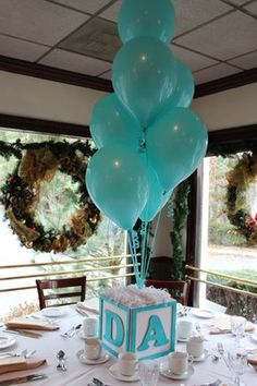 Baby Block Cube Centerpiece Silver Dazzle Stars Hanging from Clear Balloon Clusters Floating on Ceiling