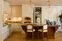 Isn't this kitchen - by Leicht Kitchen Showrooms in NY - beautiful? With a traditional base and a modern twist (look at those chandeliers!), it's got a great look!