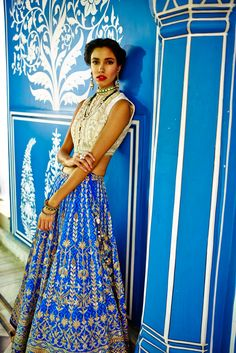 Featuring an ensemble and experience that is magical, a blue leheriya Lehenga, embellished with gota patti and zardosi. Paired with a resham bandi.