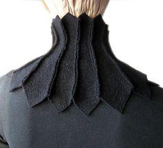 Schwarzer Kragenschal aus mehreren Walkstoffstücken apart zusammengefügt. Ein hübscher Cocon für den Hals. Länge: 18,5 cm Schalumfang: ca. 38 cm