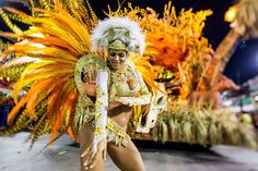 A member of Vila Isabel samba school performs during its parade at 2014 Brazilian Carnival at Sapucai Sambadrome on March 03 2014 in Rio de Janeiro...