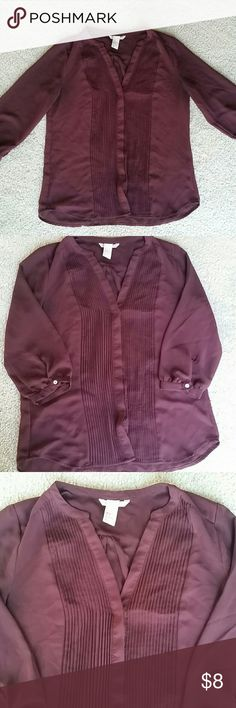 V-neck button-down blouse EUC. V-neck with hidden buttons all the way down. Color is deep purple/burgundy. 3/4 sleeve. Semi-sheer. Works well with casual outfits or even for work. H&M Tops