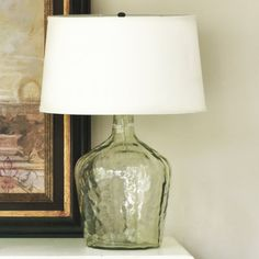 look for vintage wine bottles on ebay or at estates to turn into lamps like this one from Ballard's $149