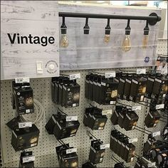 This Vintage Replacement Lightbulb Inline Display carves out a department of its own in an otherwise modern aisle. Retail Fixtures, Store Fixtures, Lightbulb, Lighting Store, Antique Stores, Inline, Vintage Lighting, Visual Merchandising, Etsy Vintage