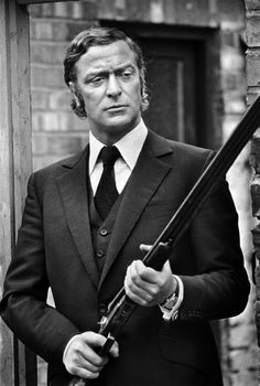 Men In Bespoke Clothes Get The Job Done. Michael Caine in Douglas Hayward, 1971.