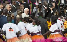 Pope Francis greets traditional dancers on his arrival at the airport in Nairobi, Kenya. Pope began his first-ever visit to Africa, a whirlwind pilgrimage to Kenya, Uganda and the Central African Republic, bringing a message of peace and reconciliation to an Africa torn by extremist violence.