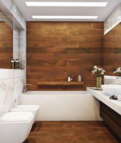 Ideias e inspirações pra decorar banheiros usando porcelanato que imita madeira. Lindos banheiros e lavabos com porcelanato madeira.