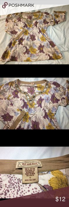 Woman's Jewel Detail Tunic Style Top Gently worn Woman's jewel detail Floral tunic style top. Size small, but fits more like a medium. Gorgeous mustard and purple flowers, 3/4 sleeves. Art and Soul Tops Tunics