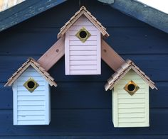 New England Bird Houses - set of 3. Fabulously coloured bird houses with cedar shingle roofs, lapped board surrounds and a side hinged door for easy cleaning. £59.95 for 3