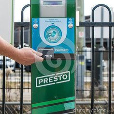 A passenger taps a Metrolinx Presto card at a machine before boarding a GO Train at the Brampton, Ontario GO Transit / VIA Rail train station. The rechargeable card allows passage on GO Trains, TTC Subways and the Union Pearson Express. Image Photography, Editorial Photography, Go Transit, Via Rail, Rail Train, Taps, Train Station, Ontario, Transportation
