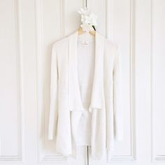 """White Ribbed Cardi Long sleeve cardigan sweater. Long sleeve. Fold over collar. Form fitting. Textured pattern at bottom. Length 28"""". Worn only once. Like new. NO TRADES Julie Brown NYC Sweaters Cardigans"""