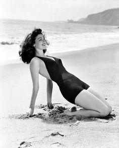 Ava Gardner stretching on Will Rogers State Beach, Los Angeles, California, c1945 .. #history #viralnetics #enternetics #girls #avagardner #losangeles #california #beach