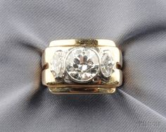18kt Gold, Platinum, and Diamond Ring, c. 1945, bezel-set with a full-cut diamond weighing approx. 2.38 cts., flanked by marquise-cut diamonds, approx. total wt. 3.00 cts., stepped shoulders, size 6 1/2, no. 90--, in Van Cleef & Arpels, New York, box.