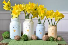 Reuse old glass food jars to create this easy spring centerpiece using chalky finish paint specifically made for glass that doesn't wash off!
