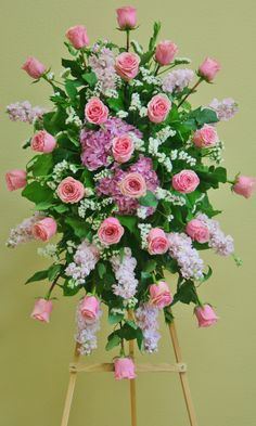 A standing spray with flowers in shades of pink, by your local Riverside florist - Willow Branch Florist of Riverside Casket Flowers, Grave Flowers, Cemetery Flowers, Funeral Flowers, Funeral Floral Arrangements, Large Flower Arrangements, Funeral Sprays, Cemetery Decorations, Casket Sprays