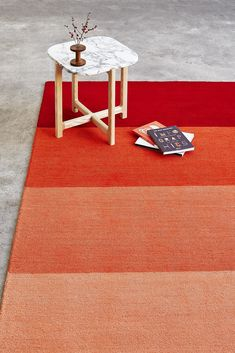 The Gradient is a mid-pile, hand-tufted rug with a bright, multi-hued ombre pattern reminiscent of modern abstract paintings. Perfect for adding color to your a small room or dorm. Joinery Details, Natural Flooring, Coffee And End Tables, Side Tables, Airplane Design, Colour Field, Wood Crosses, Hand Tufted Rugs, Geometric Lines
