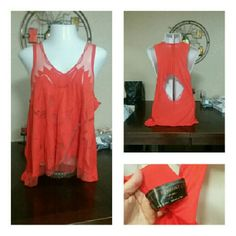 Free People Redish Orange Laser Cut Tank Tunic L BEAUTIFUL! BRAND SPANKING NEW, the tags securely attached. Free People Redish Orange Laser Cut Romantic Light Weight Tank Top Tunic in Size Large. High/Low style. Retail $138.00 Free People Tops Tunics