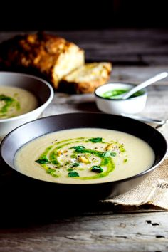Celeriac & roasted garlic soup with parsley oil.