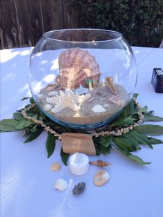 Beach wedding, Hawaiian theme centerpieces, seashells, sand, DIY wedding