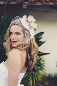 this bride is very smugly enjoying a cocktail in her cocktail hat, indeed.  ~  FREE SHIPPING Champagne Toast bridal cocktail hat by PetalAndThorn, $160.00