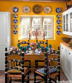 Espinar scoured flea markets to find the old Mexican cantina chairs — no two are exactly alike — and made cushions out of Mexican embroidery. Tumbled brick floor from Kinney Brick Co.   - HouseBeautiful.com