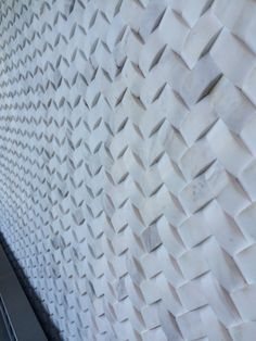 White Carerra Marble, Braided Herringbone Tile As A Feature Wall. Seen At  PERCH In
