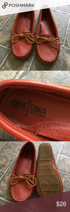 Red Minnetonka Moccasins Original style red leather moccasins with rawhide ties. Perfect condition. Minnetonka Shoes Moccasins