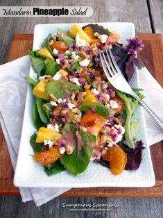 Mandarin Pineapple Salad with Basil Flowers, walnuts and goat cheese...topped with strawberry honey poppy seed dressing