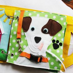 Give the Dog a Bone - a multi-activity single page to add to your custom book. Dog can be customized to look like your pet! Buckle the dogs collar, clip the dogs leash, and give the dog a bone. The bone has velcro to stick to the doggies tongue. This is also a sensory page- the dogs ears are furry and the nose is rubbery. You can choose the dog breed, or if you can send a picture of the furry friend you would like to replicate!  Quiet Books are a great way to keep your little ones occupied…
