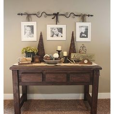 ideas for decor for a table and also like the wall picture hanging