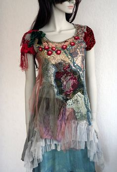 Renaissance inspiration with bohemian flair. Romantic layered and floaty tunic in shades of teal, gray and green; accentuated with lush reds, gold