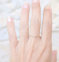 Tiny Infinity Ring - 14k gold filled delicate chain ring with a tiny handmade infinity, gold ring,simple gold ring,everyday. $12,00, via Etsy.